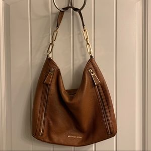 Michael Kors tan brown shoulder bag.